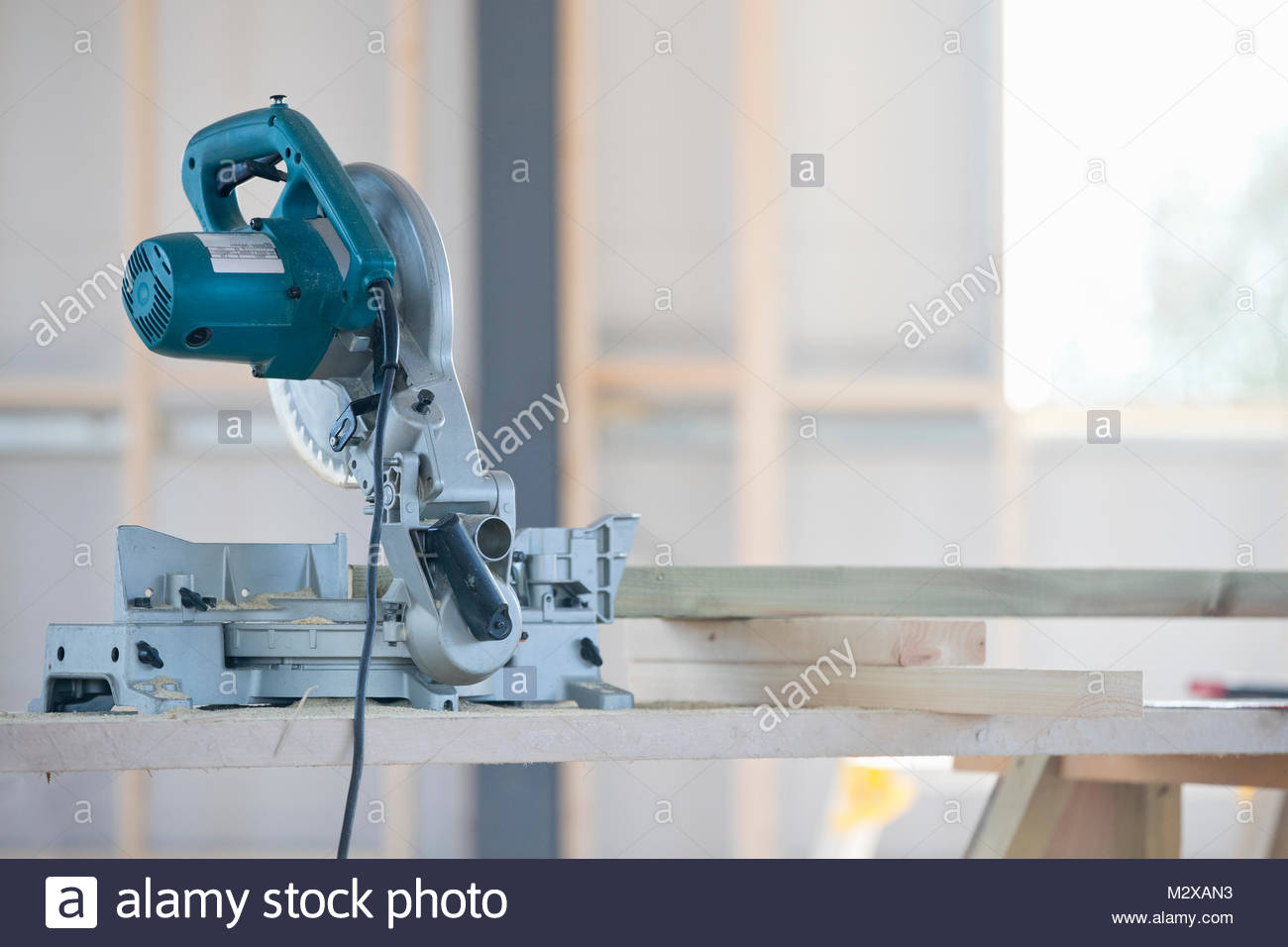 Circular power saw tool in construction site interior - Stock Image