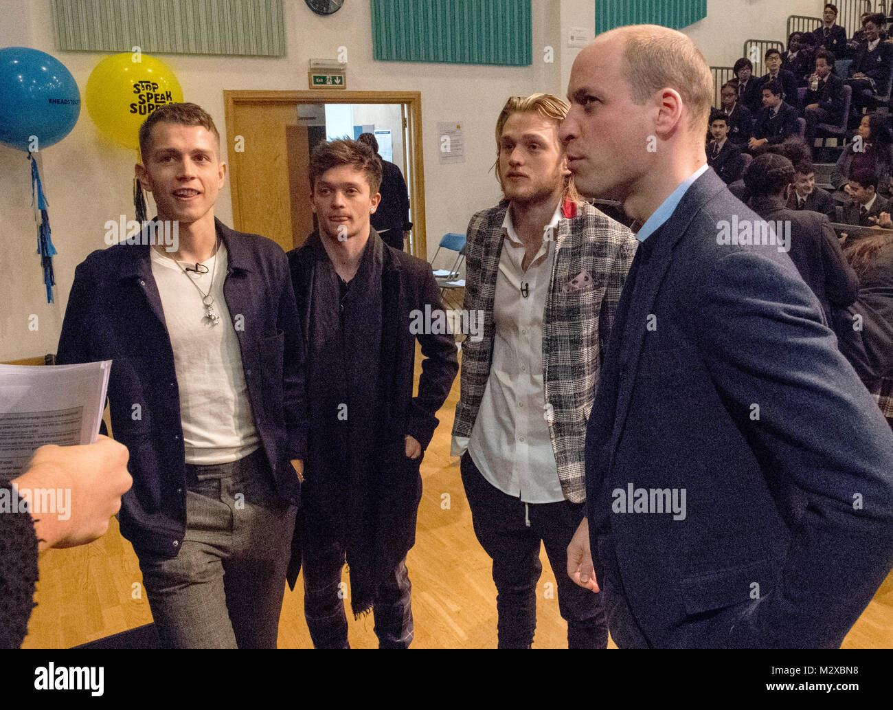 The Duke of Cambridge with The Vamps band members as he makes an unannounced visit to Burlington Danes Academy in - Stock Image