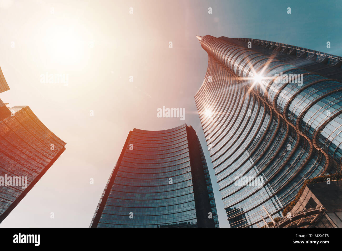 Central tower of the building complex designed by Argentine Architect Cesar Pelli in Piazza Gae Aulenti - Stock Image