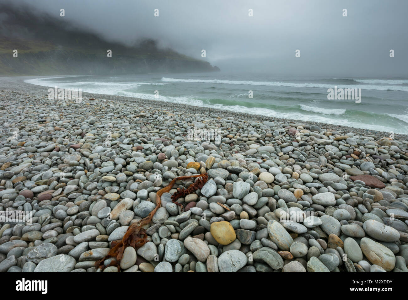 Sea fog shrouds Dookinelly beach, Achill Island, County Mayo, Ireland. - Stock Image