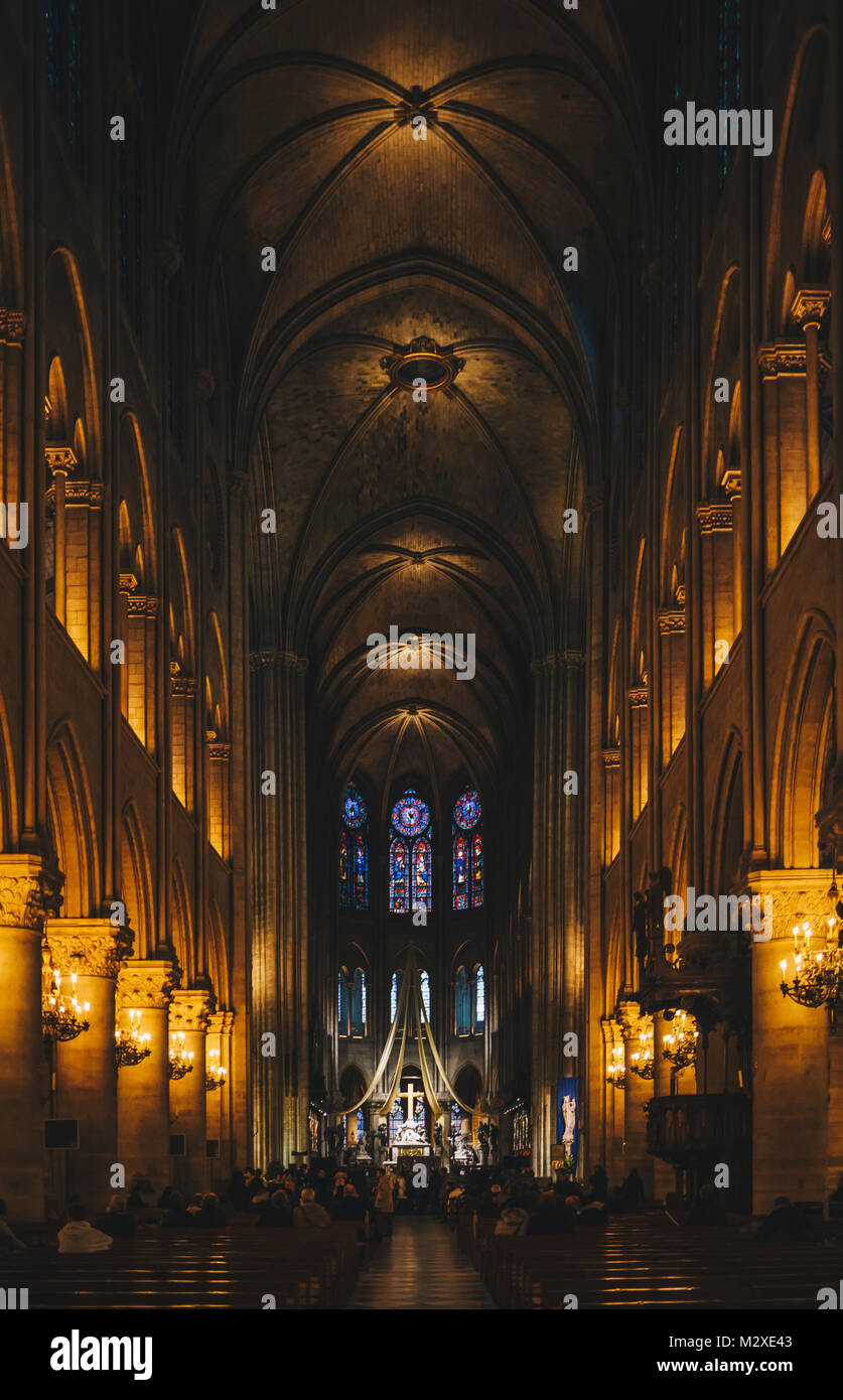 Paris, France - Nov 29, 2013: Interior view of Notre-Dame Cathedral, one of finest examples of French Gothic architecture Stock Photo