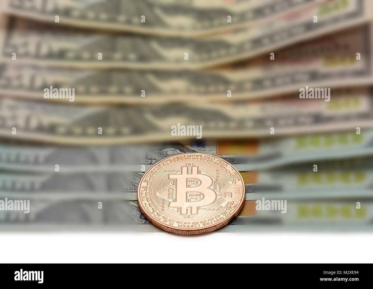 Platinum coin of Bitcoin lies closeup on blurred background Stock Photo