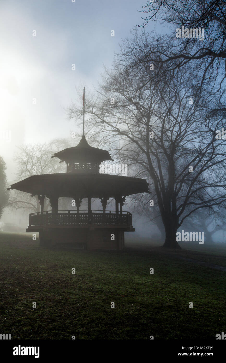 The Haywood bandstand in Alexandra Park just off Beach Ave in Vancouver BC in a silhouette with green grass and - Stock Image
