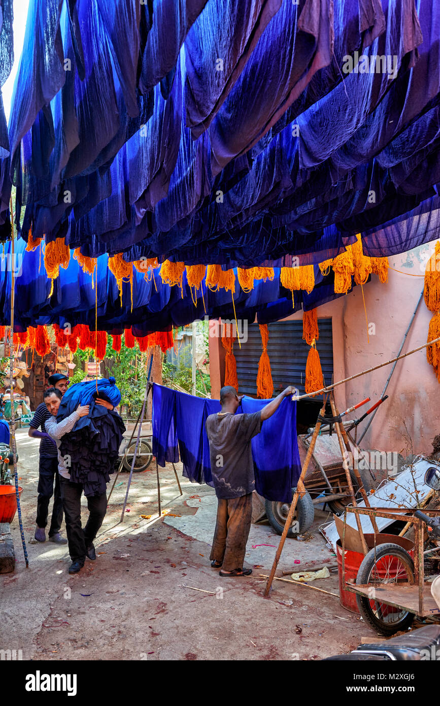Brightly coloured wool hanging to dry in the dyers souk,  textile souk of Marrakesh, Morocco, Africa Stock Photo