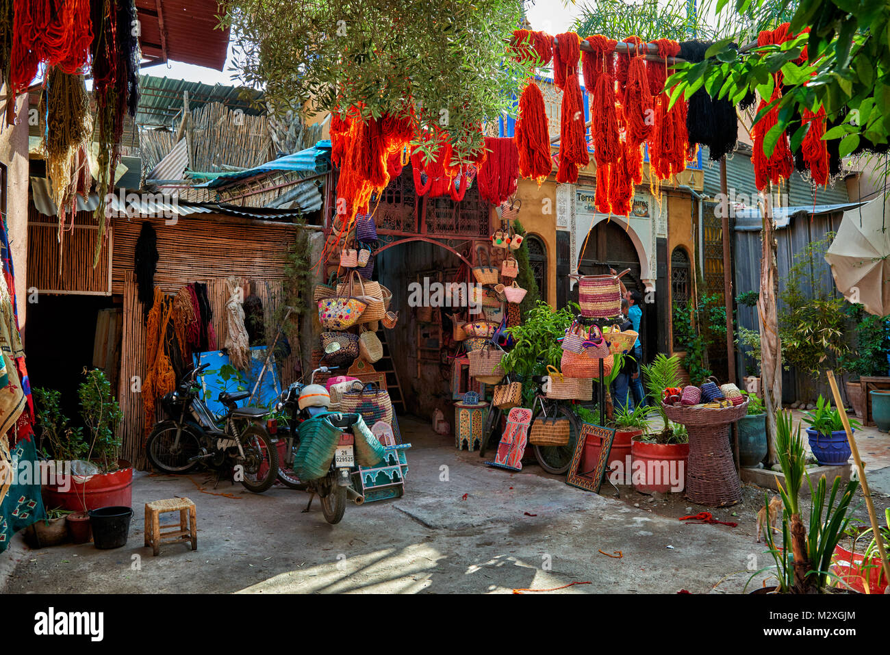 Brightly coloured wool hanging to dry in the dyers souk,  textile souk of Marrakesh, Morocco, Africa - Stock Image