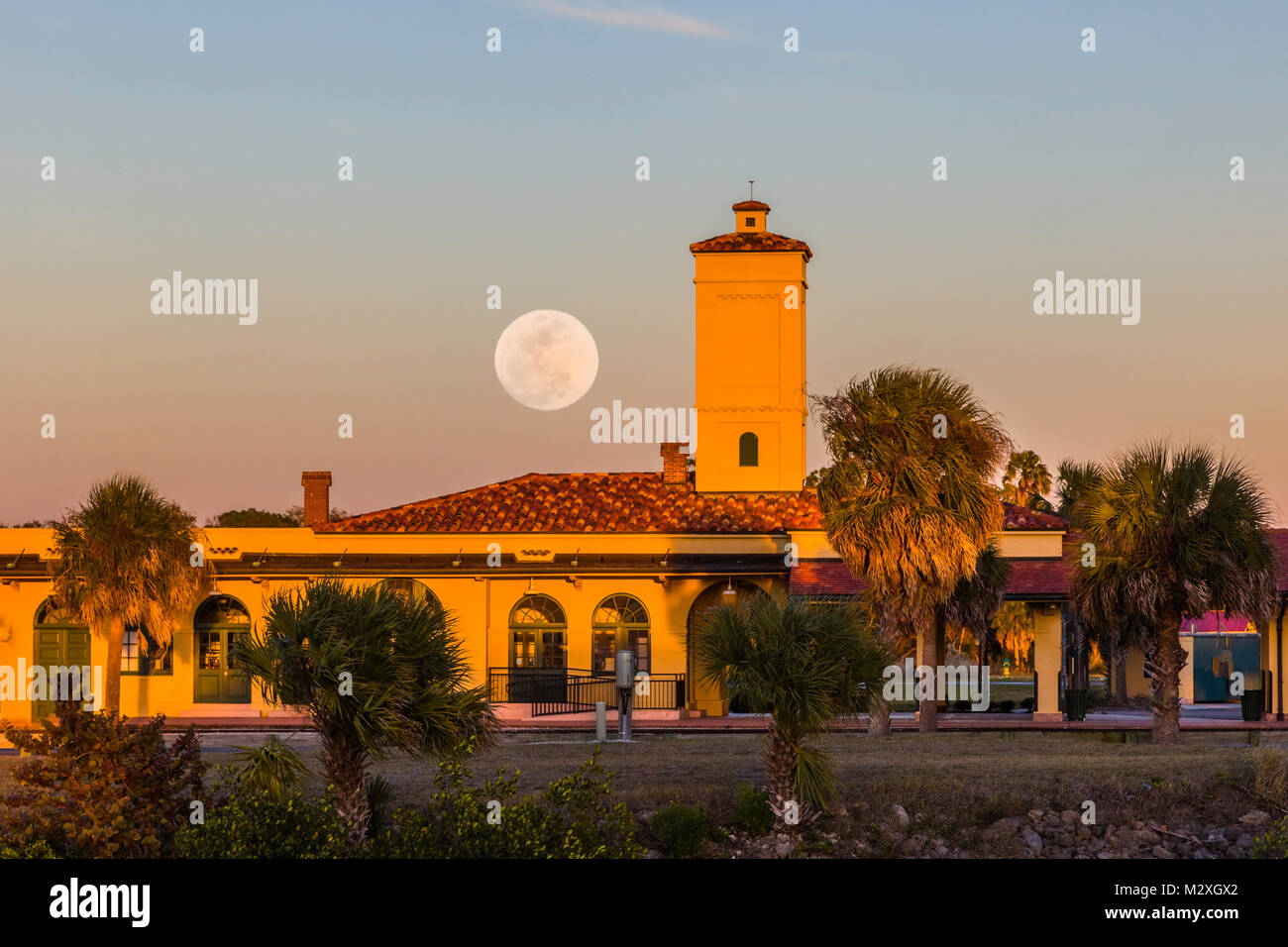Moon coming up over historic Venice Seaboard Air Line Railway Station also known as the Venice Train Depot in Venice - Stock Image