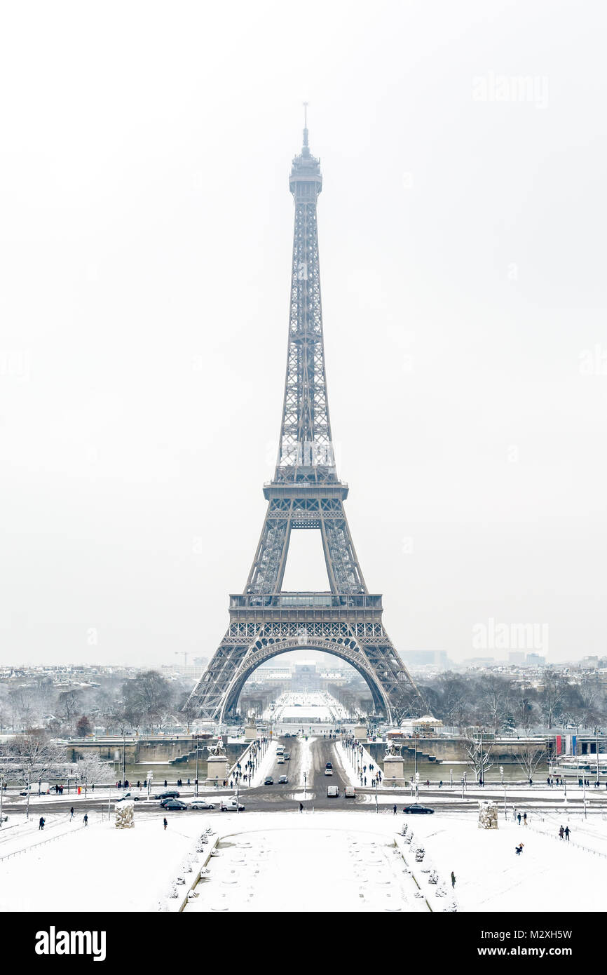 Winter in Paris in the snow. The Eiffel tower seen from the Trocadero Esplanade by a snowy winter day. Stock Photo