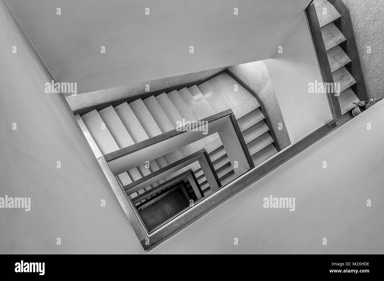 Top view of the stairwell in masonry and marble, floors seen from the stairs - Stock Image