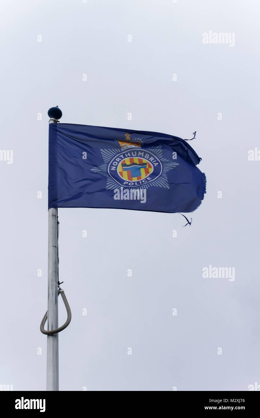 Flag of Northumbria police force flying on a flagpole with dead space outside Etal Lane police station, Newcastle - Stock Image
