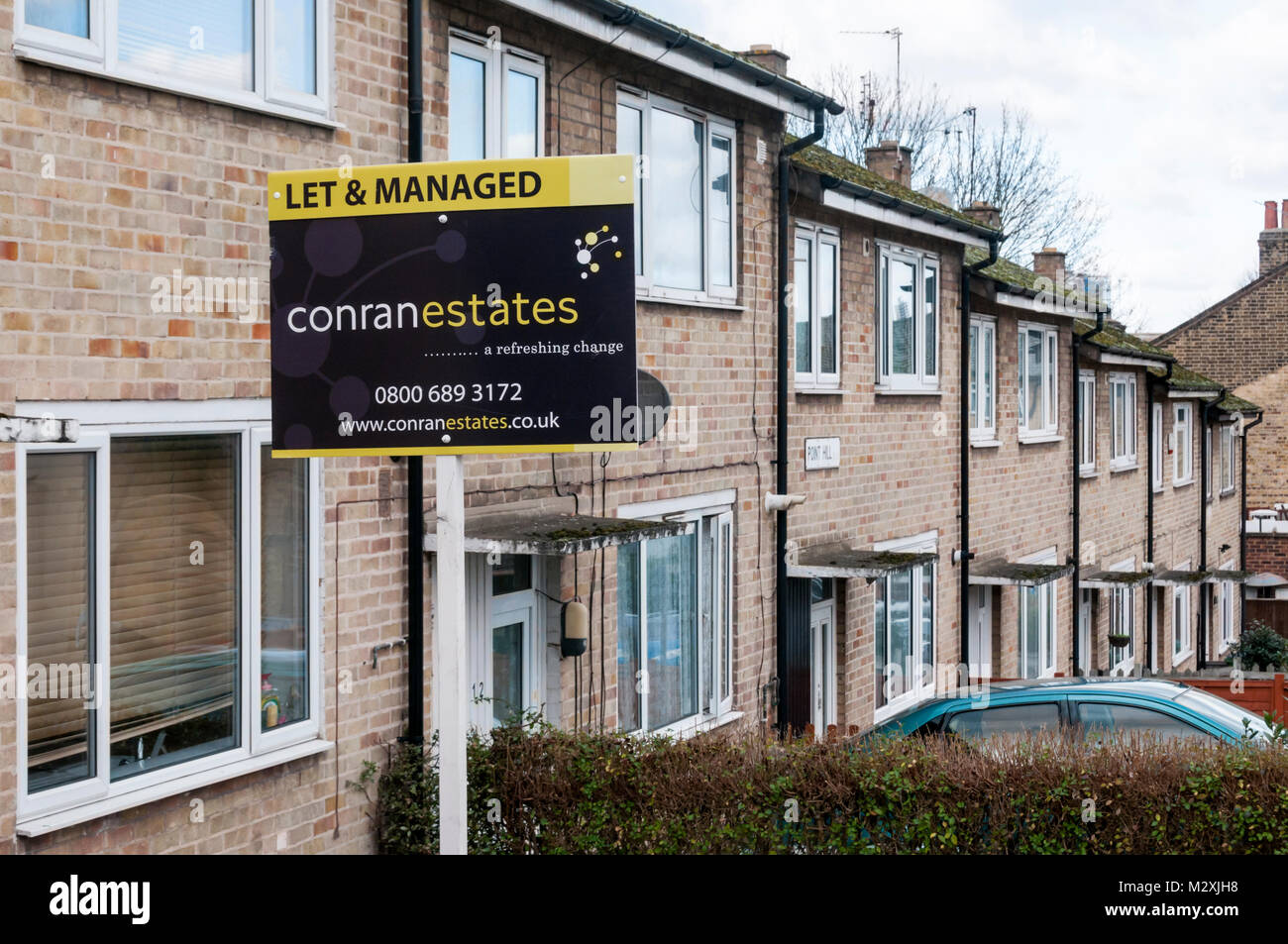 Let & Managed sign on private rental property at market rent in terrace of properties previously public owned - Stock Image