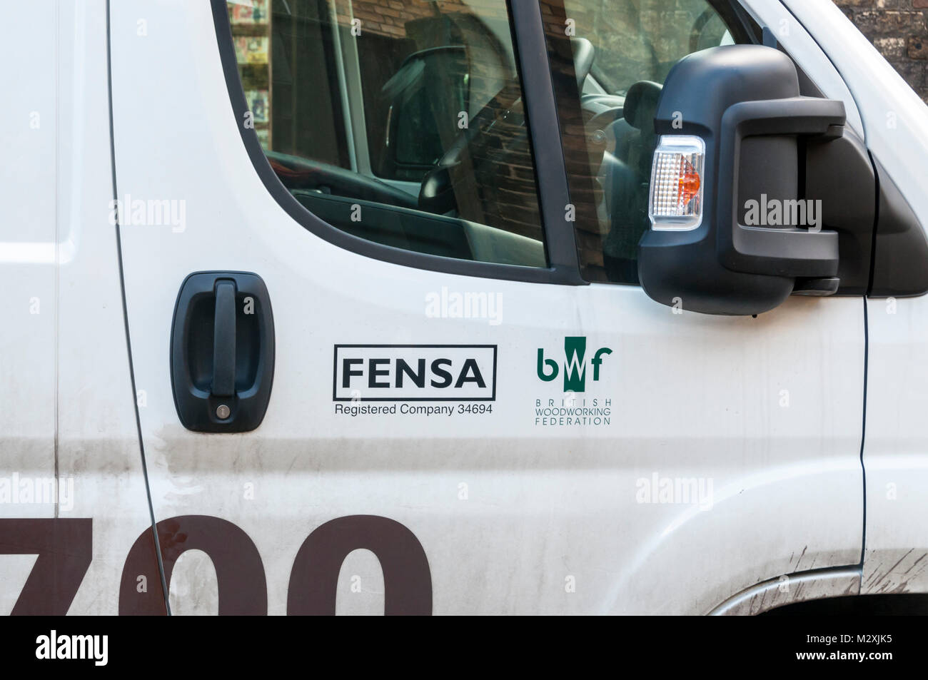 Sign on side of van shows company is member of FENSA a competent person certificate issuing authority for window - Stock Image