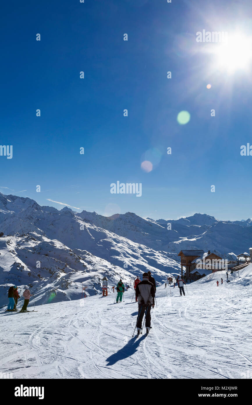 skiers, mountains and piste, Courchevel, Savoie, France. - Stock Image