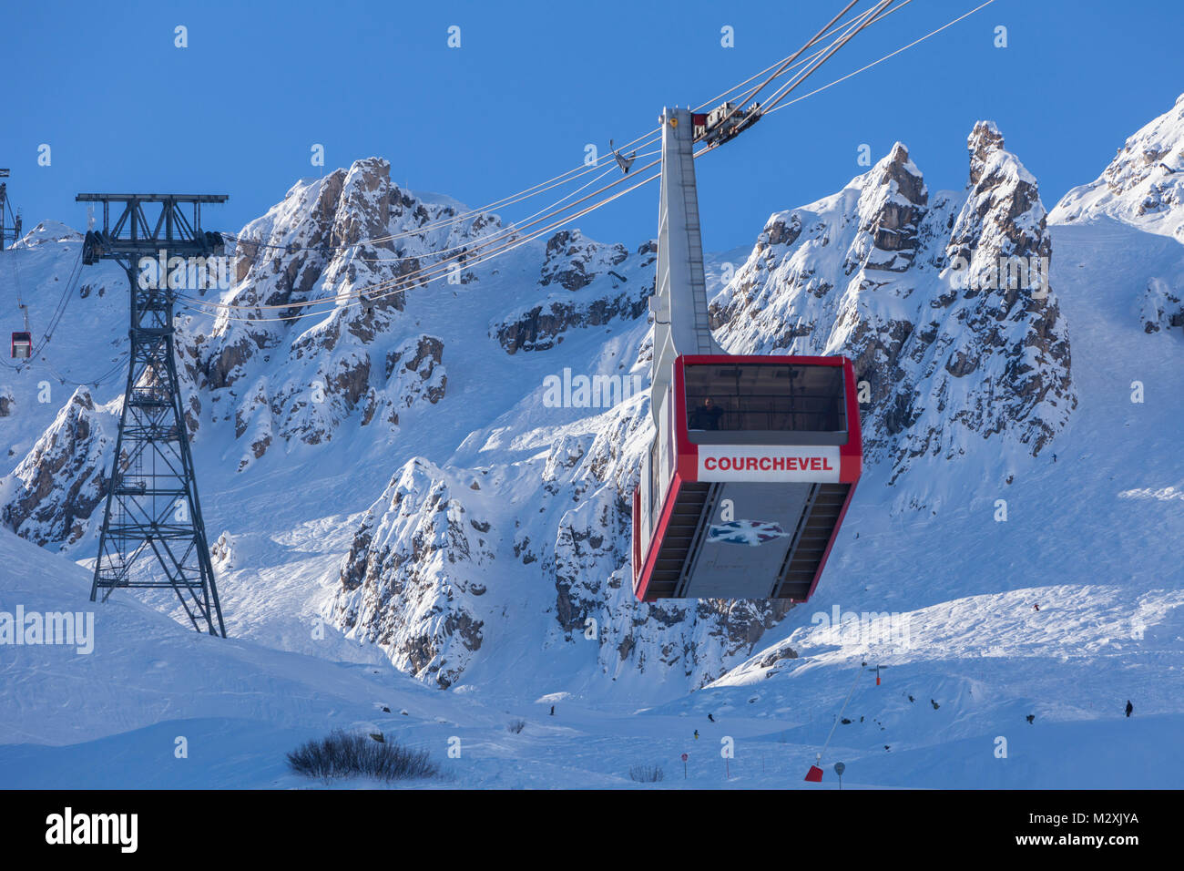 Gondola, mountains and piste, Courchevel, Savoie, France. - Stock Image