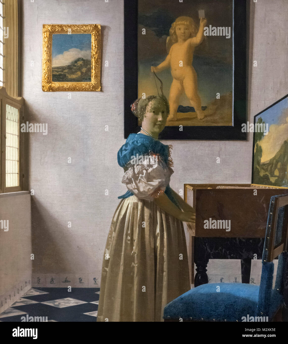 Young Woman standing at a Virginal by Johannes Vermeer, oil on canvas, c.1670-72 - Stock Image