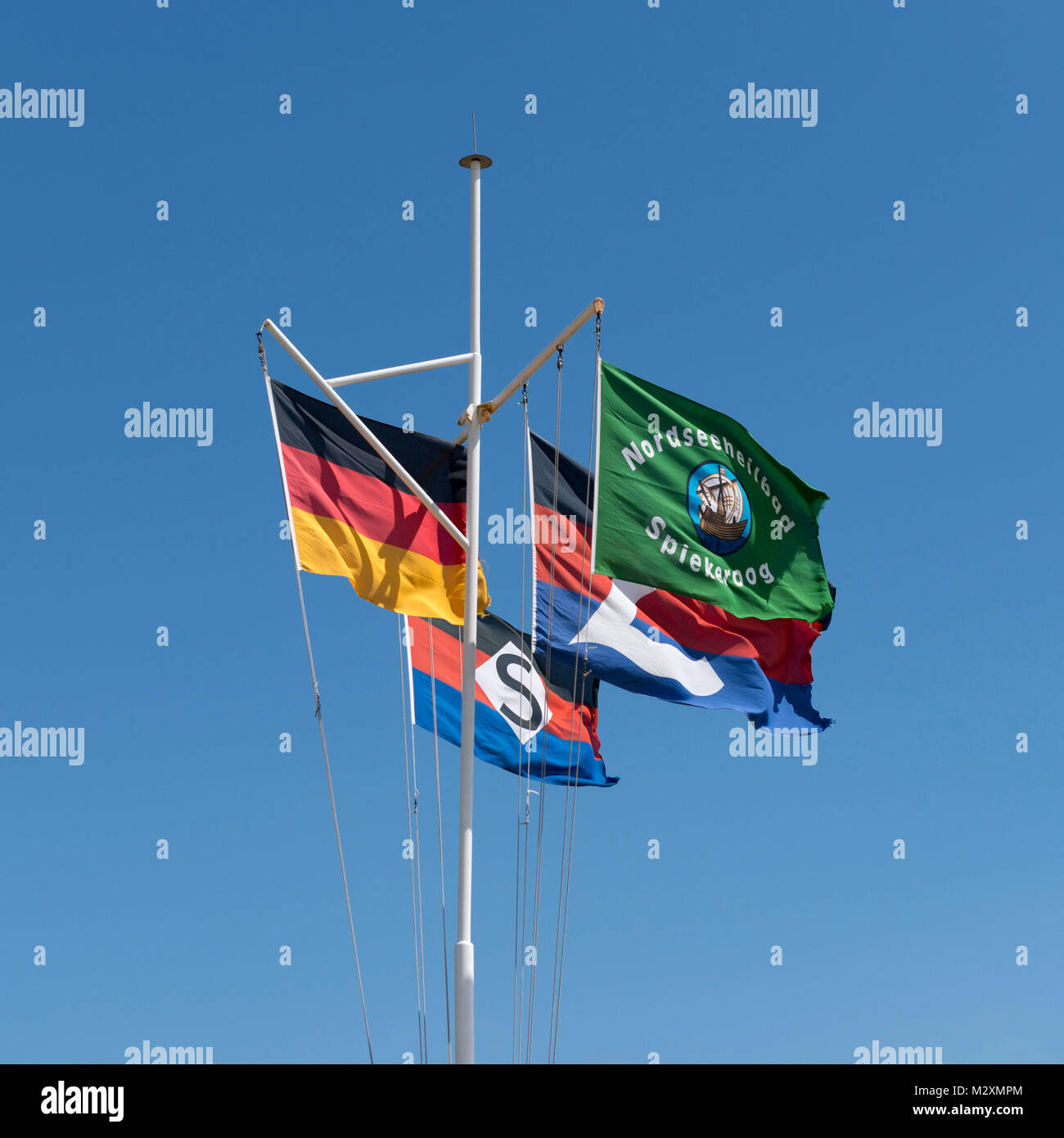 Germany, Lower Saxony, East Friesland, East Frisian islands, flagpole in the harbour of Spiekeroog. - Stock Image