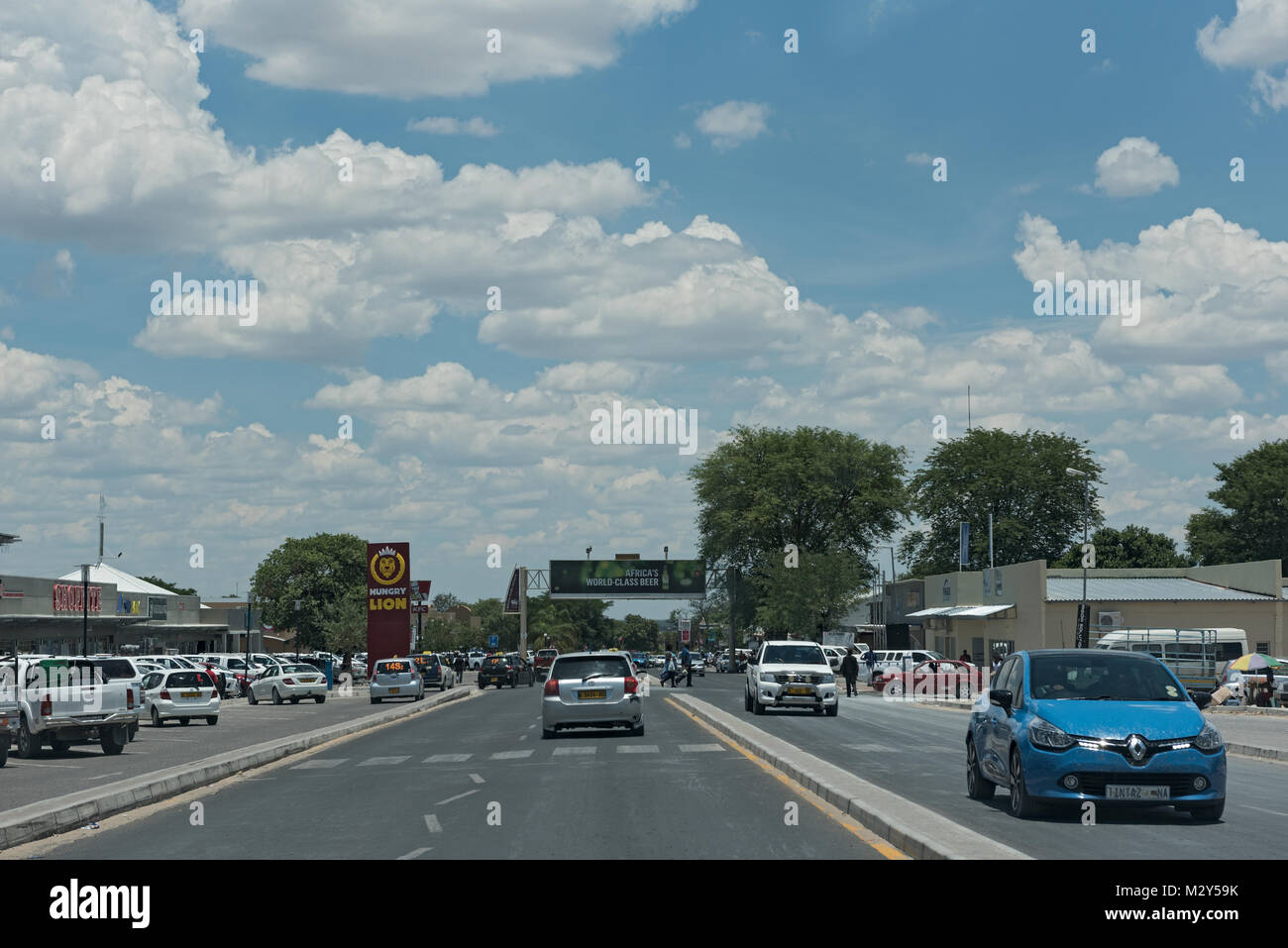 Cars on a main street in the city Rundu in the north of Namibia - Stock Image