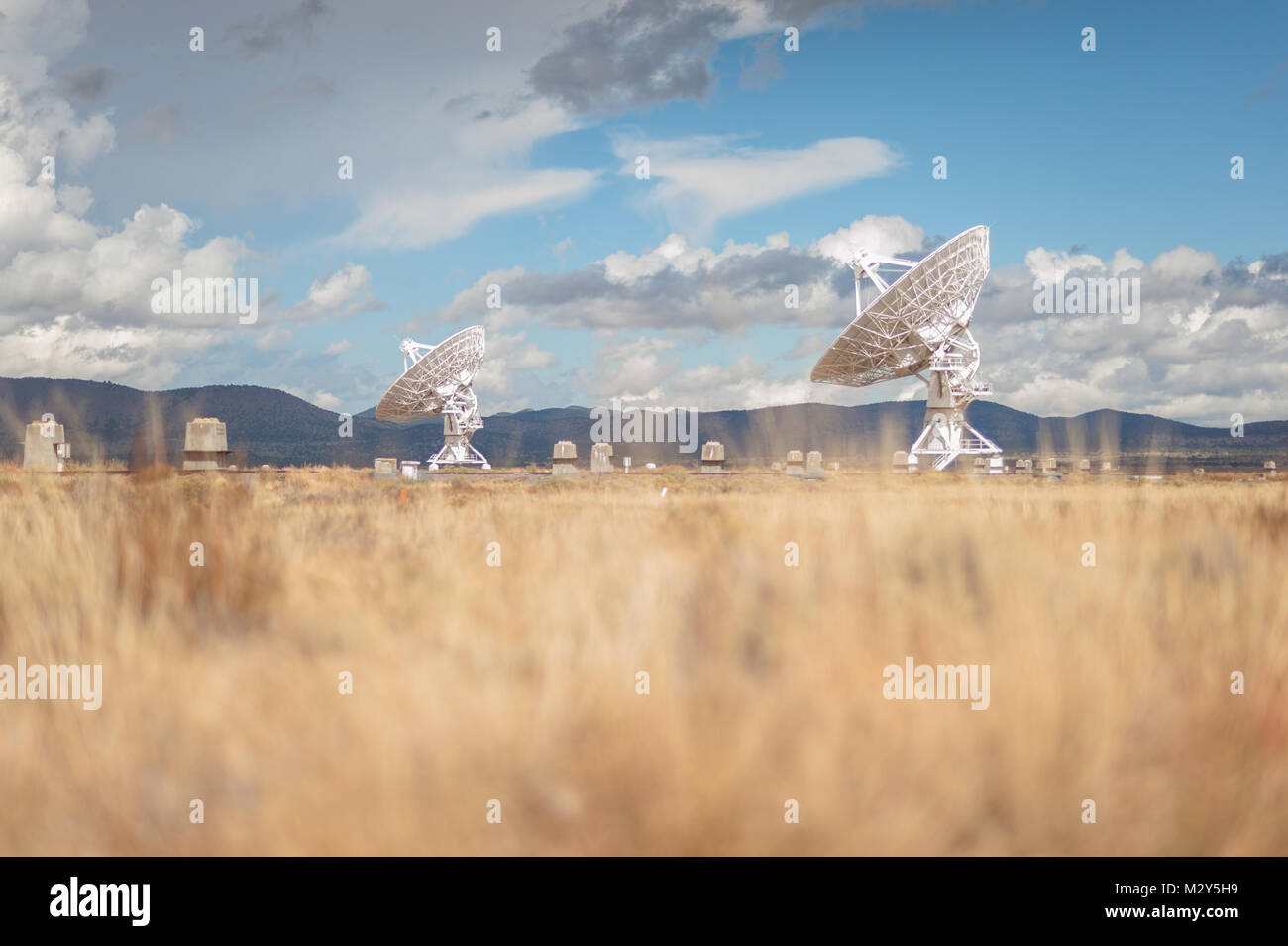 Very Large Array (VLA) Radio Telescopes with nature in the foreground located at the National Radio Astronomy Observatory Stock Photo