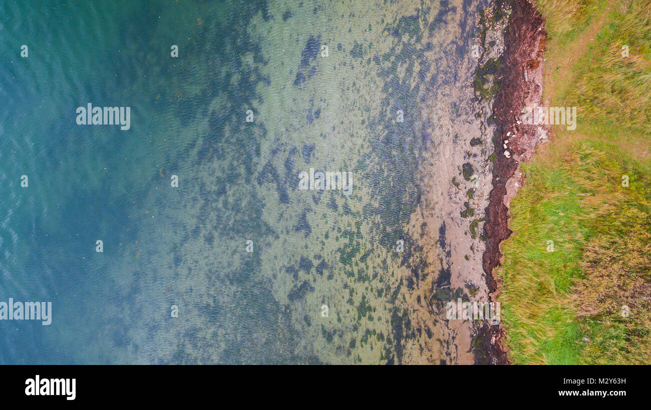 Pollution and dirt from the sea water, seen from above. Ecological pollution concept - Stock Image