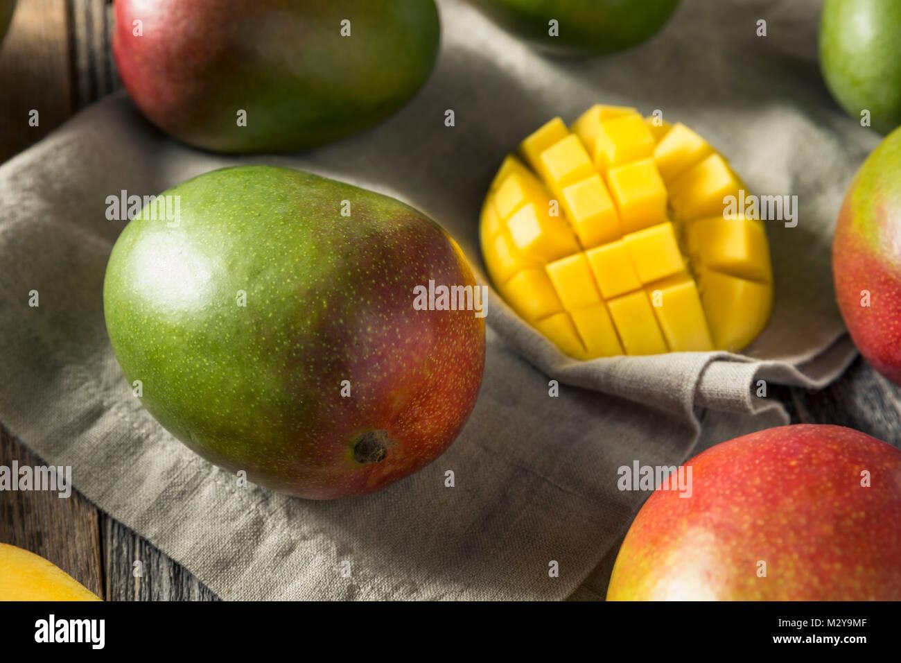 Raw Red Green Organic Mango Fruit Ready to Eat - Stock Image