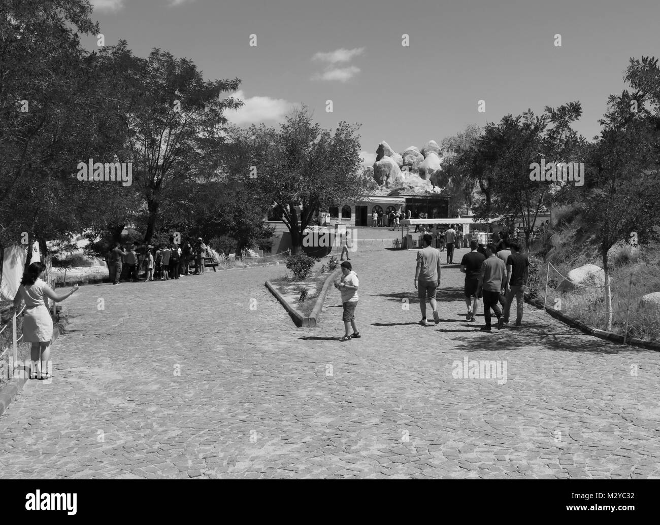 Tourists visiting the National park Open air museum in Cappadocia, Turkey, Goreme - Stock Image