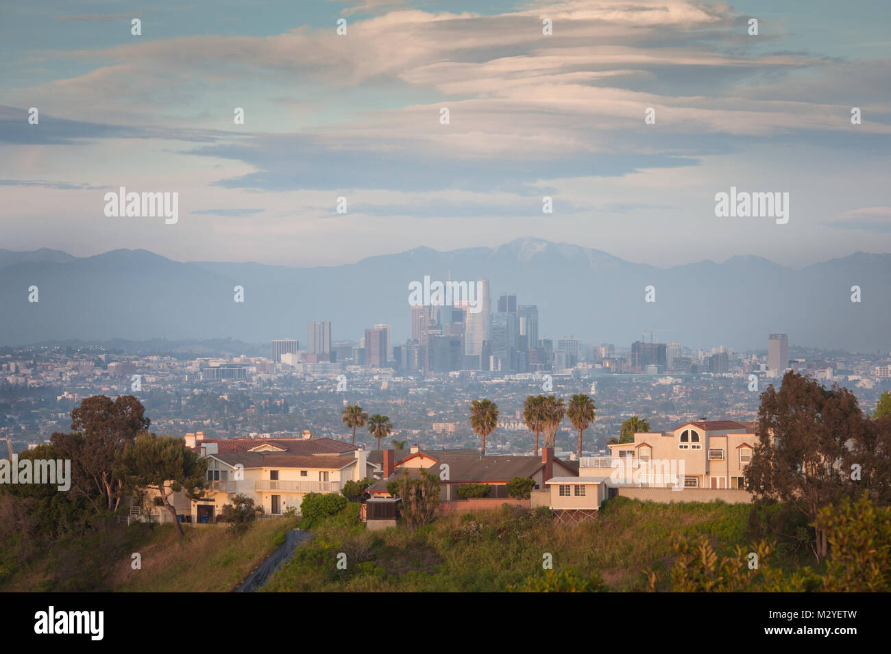 View of Downtown L.A with houses in the foreground photographed at sunset from the top of the Kenneth Hahn State Stock Photo