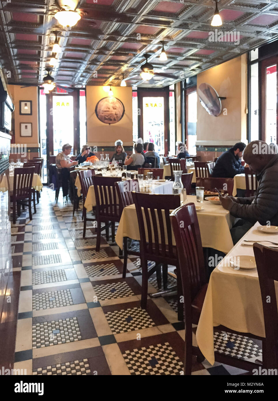 Interior of Grotto Azzurra in the Little Italy neighborhood, Manhattan, New York City. People dining out in traditional - Stock Image