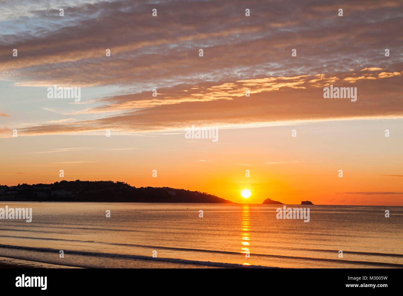 England, Devon, Torquay, Sunrise Over Torbay - Stock Image