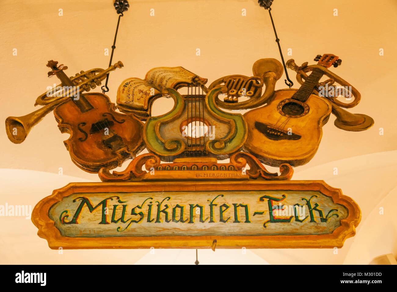 Germany, Bavaria, Munich, Hofbrauhaus, Wooden Music Sign Board - Stock Image