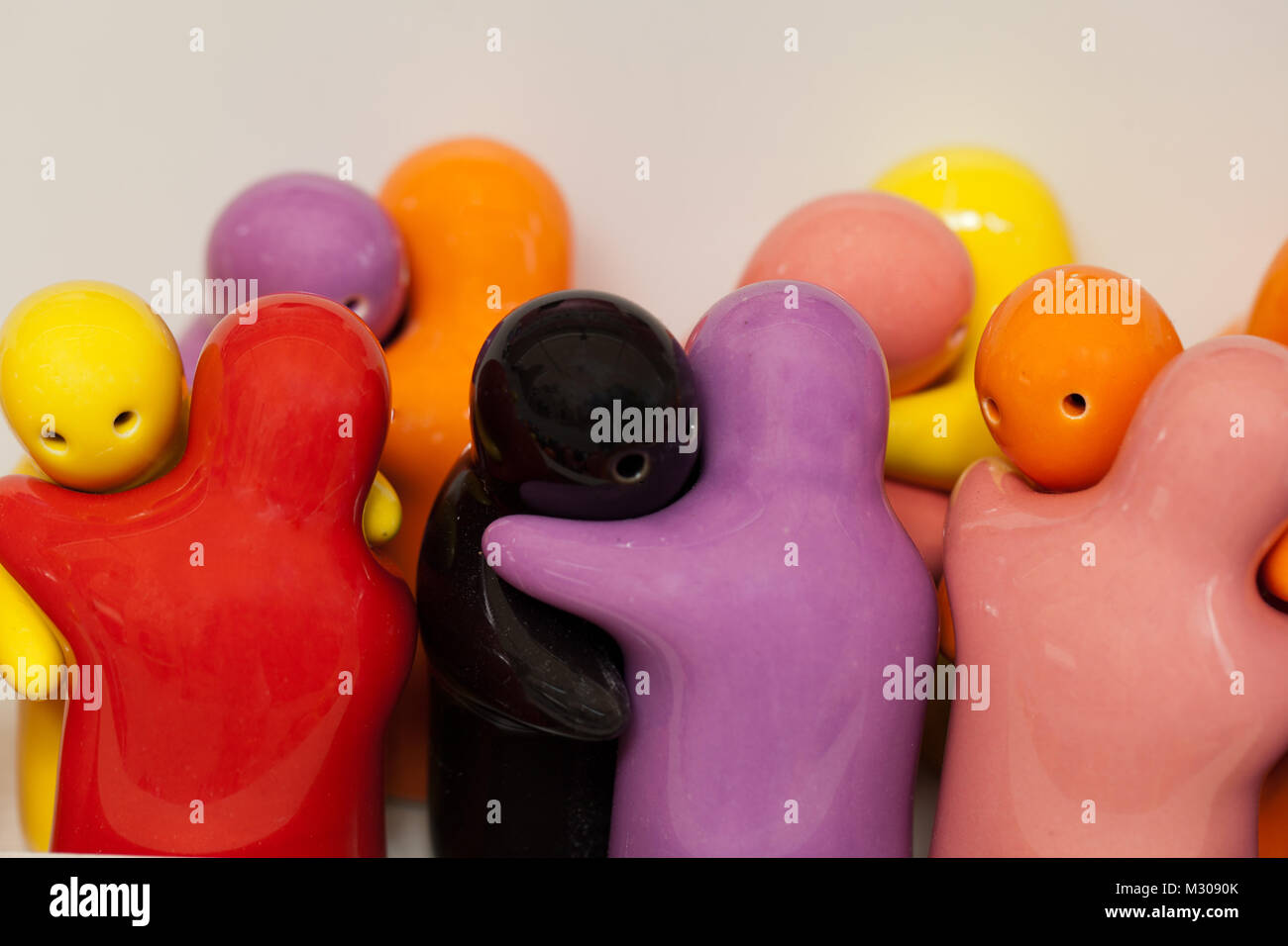 coloured figurines - the symbol of love and the tolerance - Stock Image
