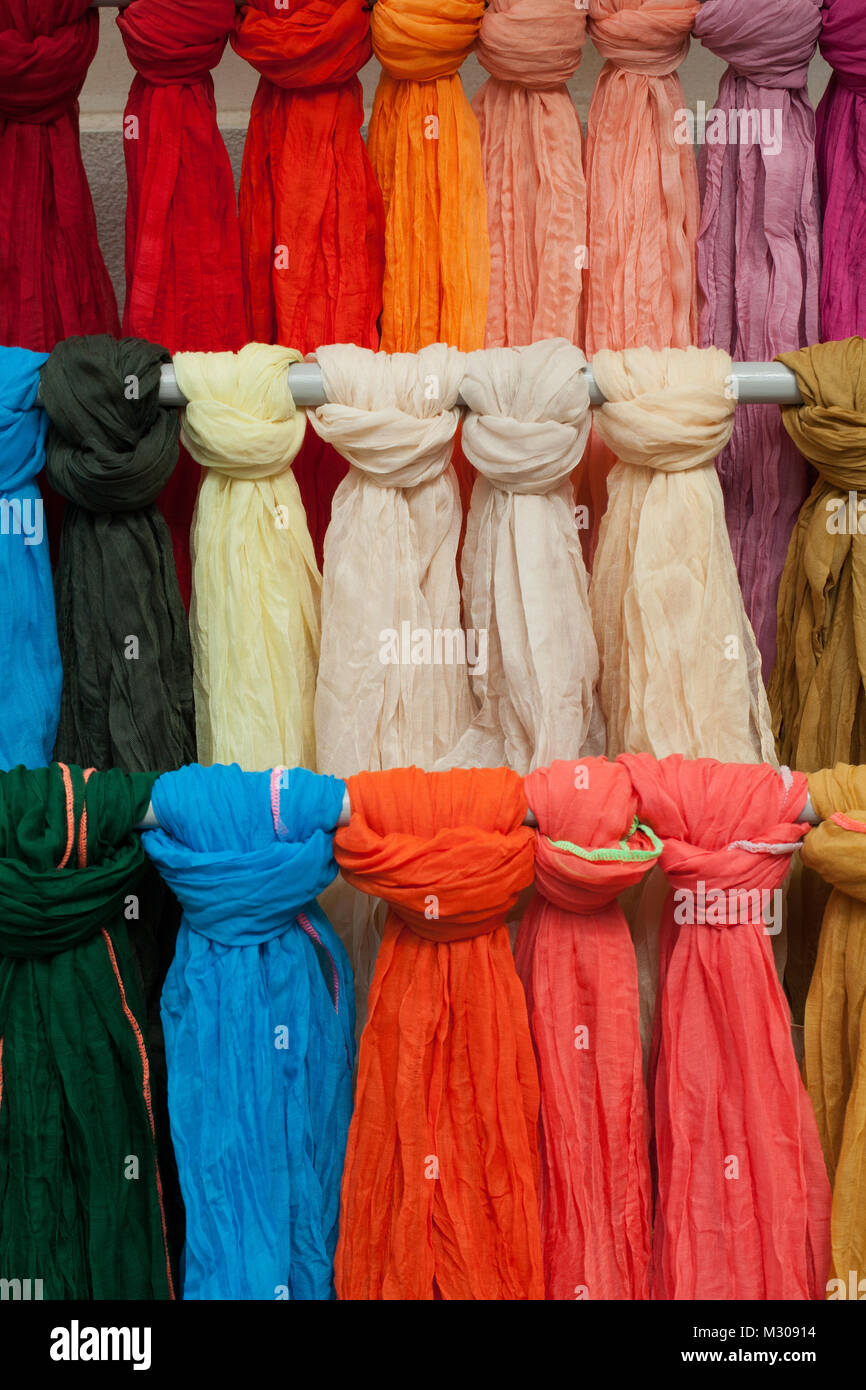 Colorful shawls or scarfes in a market stall - Stock Image