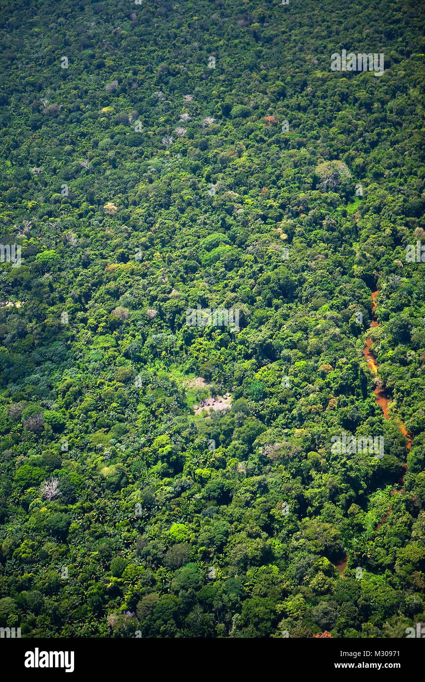 Suriname, Laduani, at the bank of the Boven Suriname river. Aerial of nearby little settlement in forest. - Stock Image
