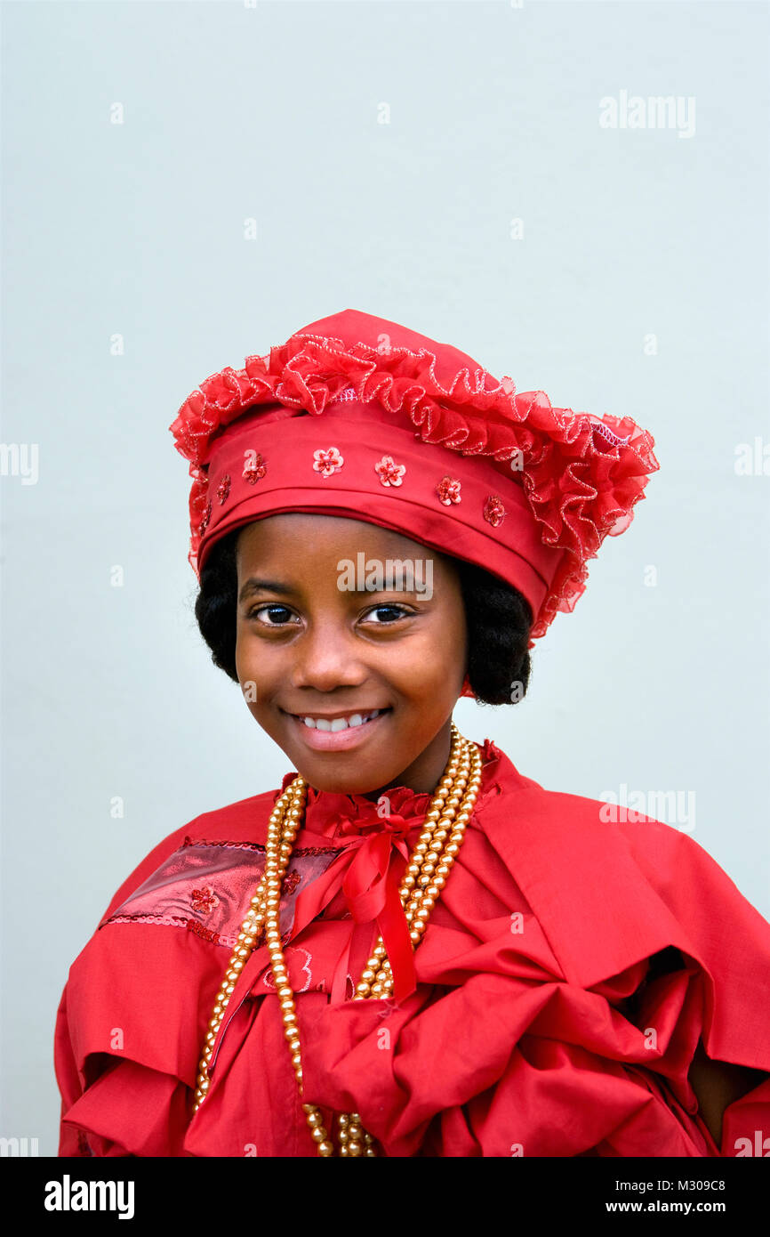 Suriname, Paramaribo. Creole girl in Kotomisi dress,  the national creole costume. - Stock Image