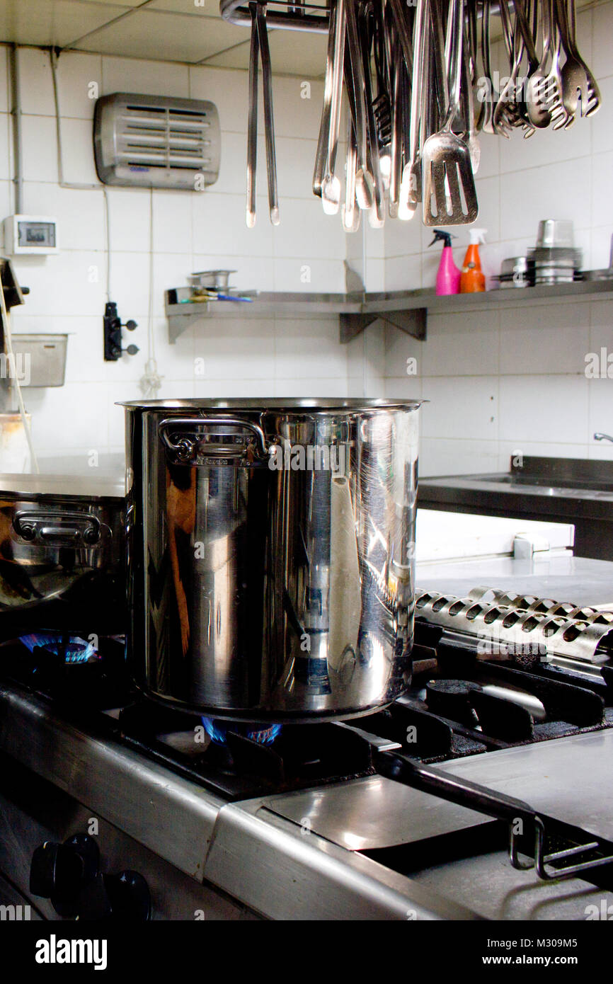 Large Steel Professional Pan On The Stove With Fire In Restaurant Kitchen