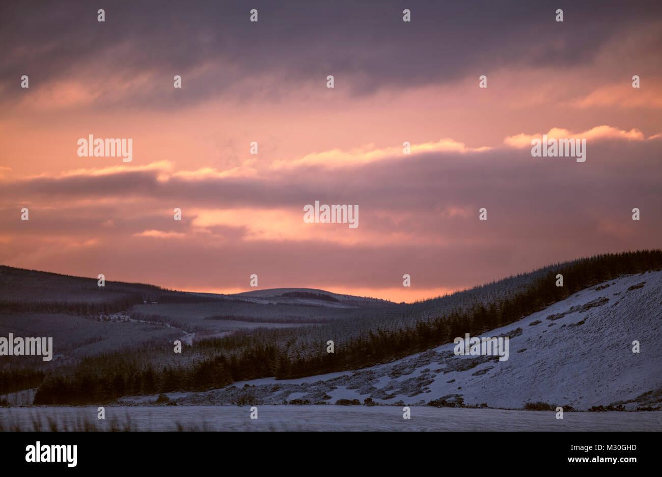 Sun rise in Scotland over hills - Stock Image