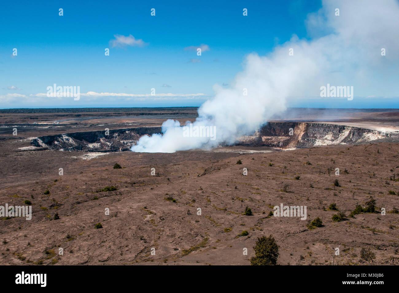 Smoking K?lauea Summit Lava Lake in the Hawaii Volcanoes National Park, Big Island, Hawaii - Stock Image