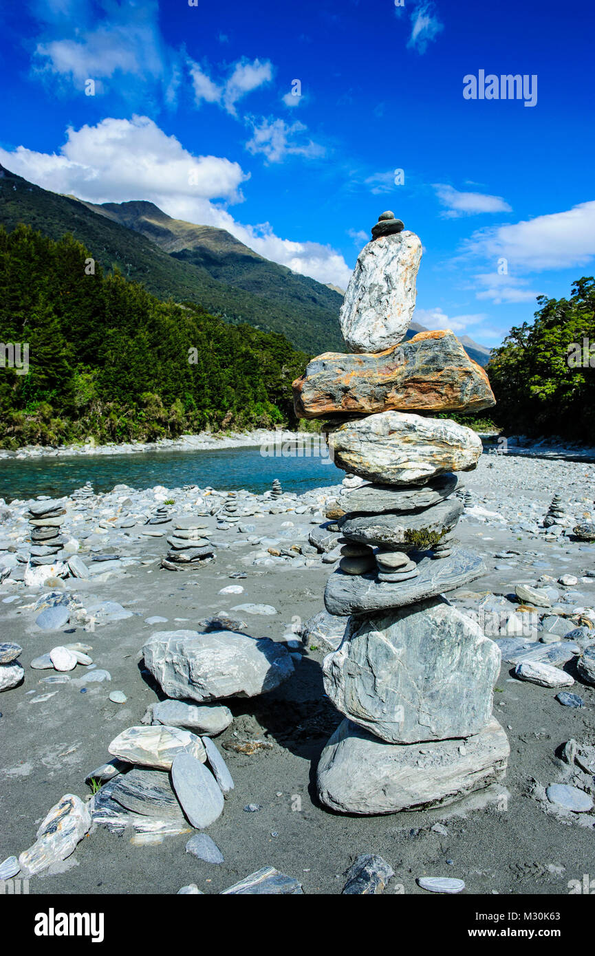 Man made stone pyramids at the Blue Pools, Haast Pass, South Island, New Zealand - Stock Image