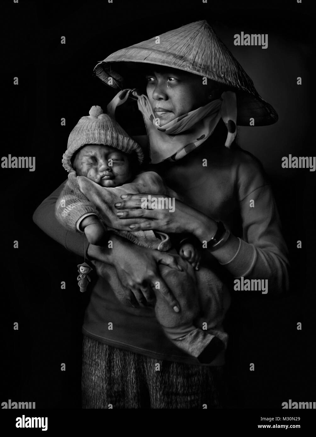 Mother with baby in Hanoi, Vietnam, Indochina, Asia - Stock Image