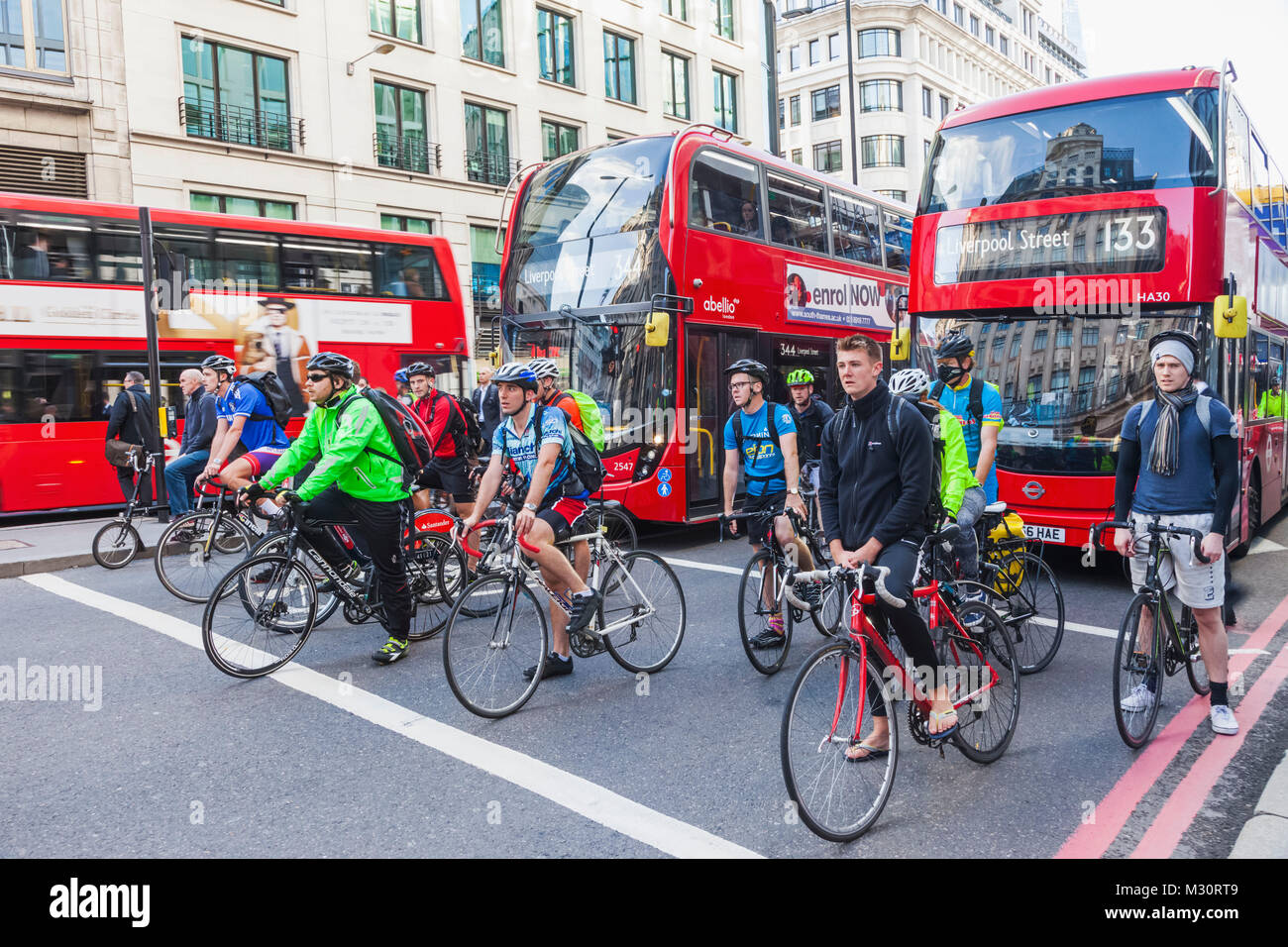 England, London, London Bridge, Cyclists Commuting to Work - Stock Image
