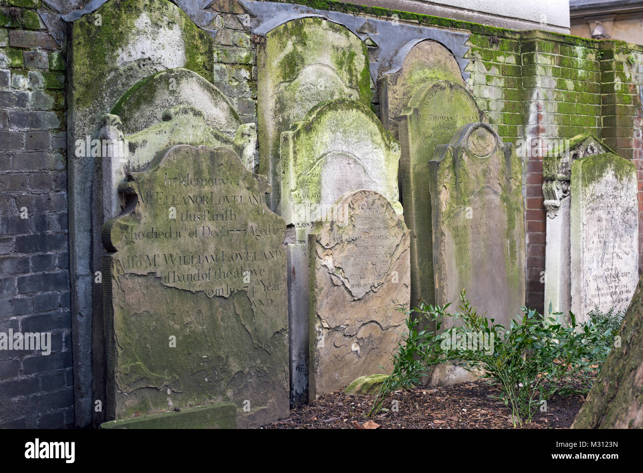 London, England, February 2018, graves packed tightly in a city graveyard - Stock Image