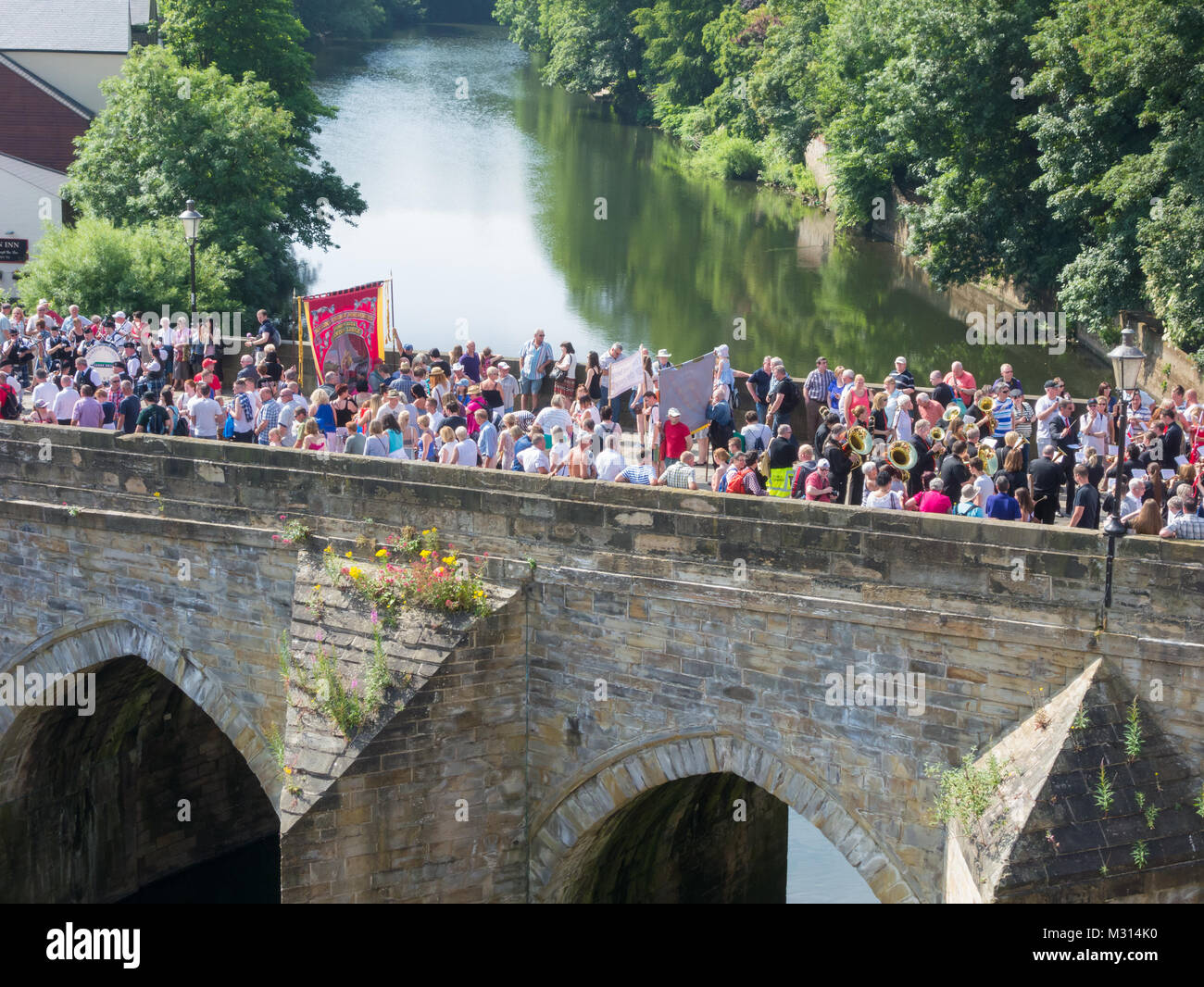Durham Miners Gala parade crossing Elvet bridge in Durham. UK - Stock Image