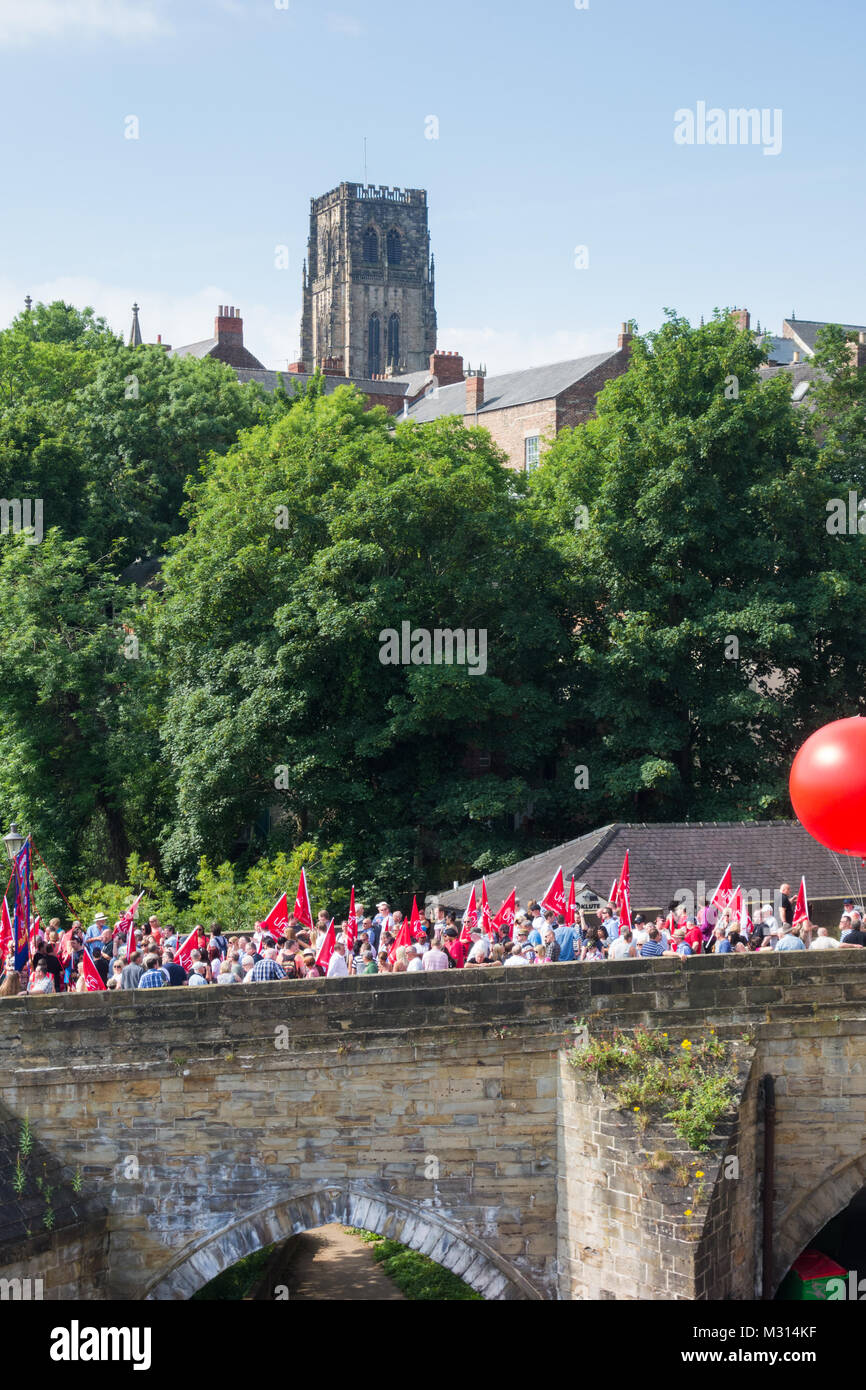 Durham Miners Gala parade crossing Elvet bridge with cathedral in background. Durham. UK - Stock Image
