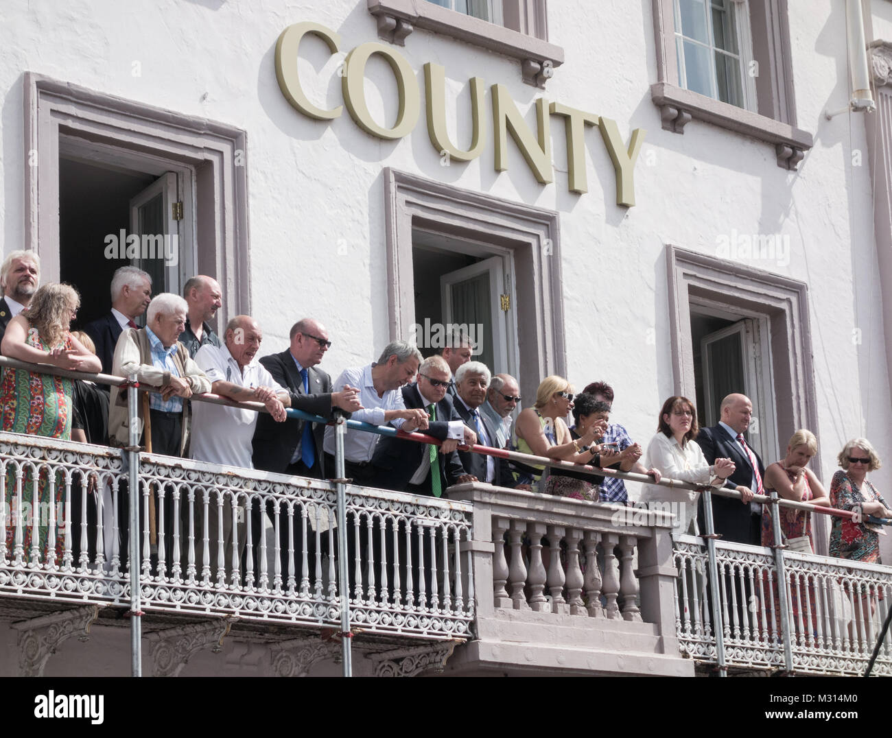 Union leaders, politicians and celebrites watch the parade from the County Hotel at Durham Miners Gala. Durham, - Stock Image