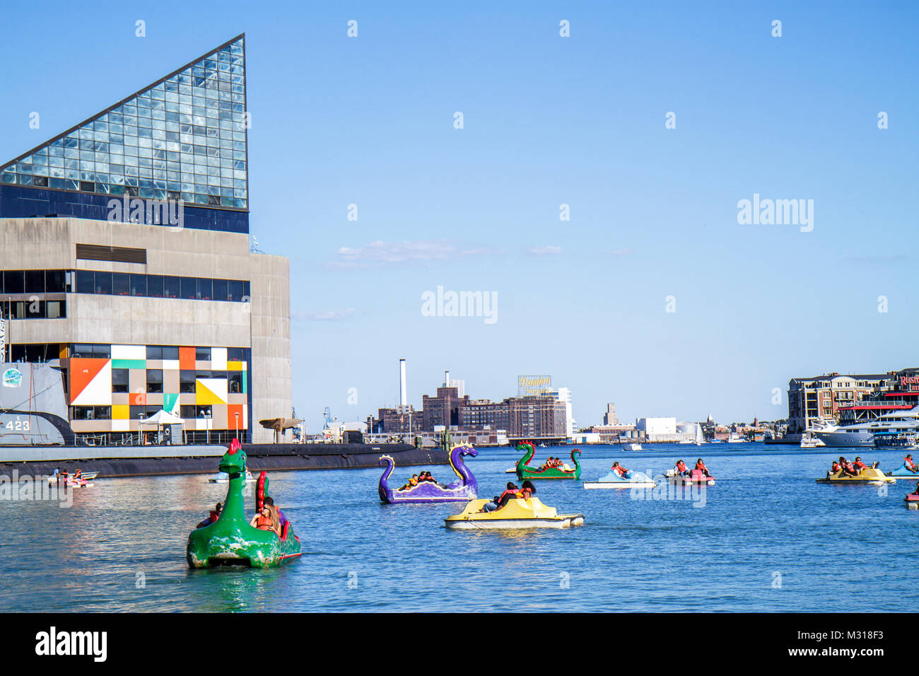 Baltimore Maryland Inner Harbor Patapsco River port waterfront Harborplace National Aquarium paddle boat ride dragon - Stock Image