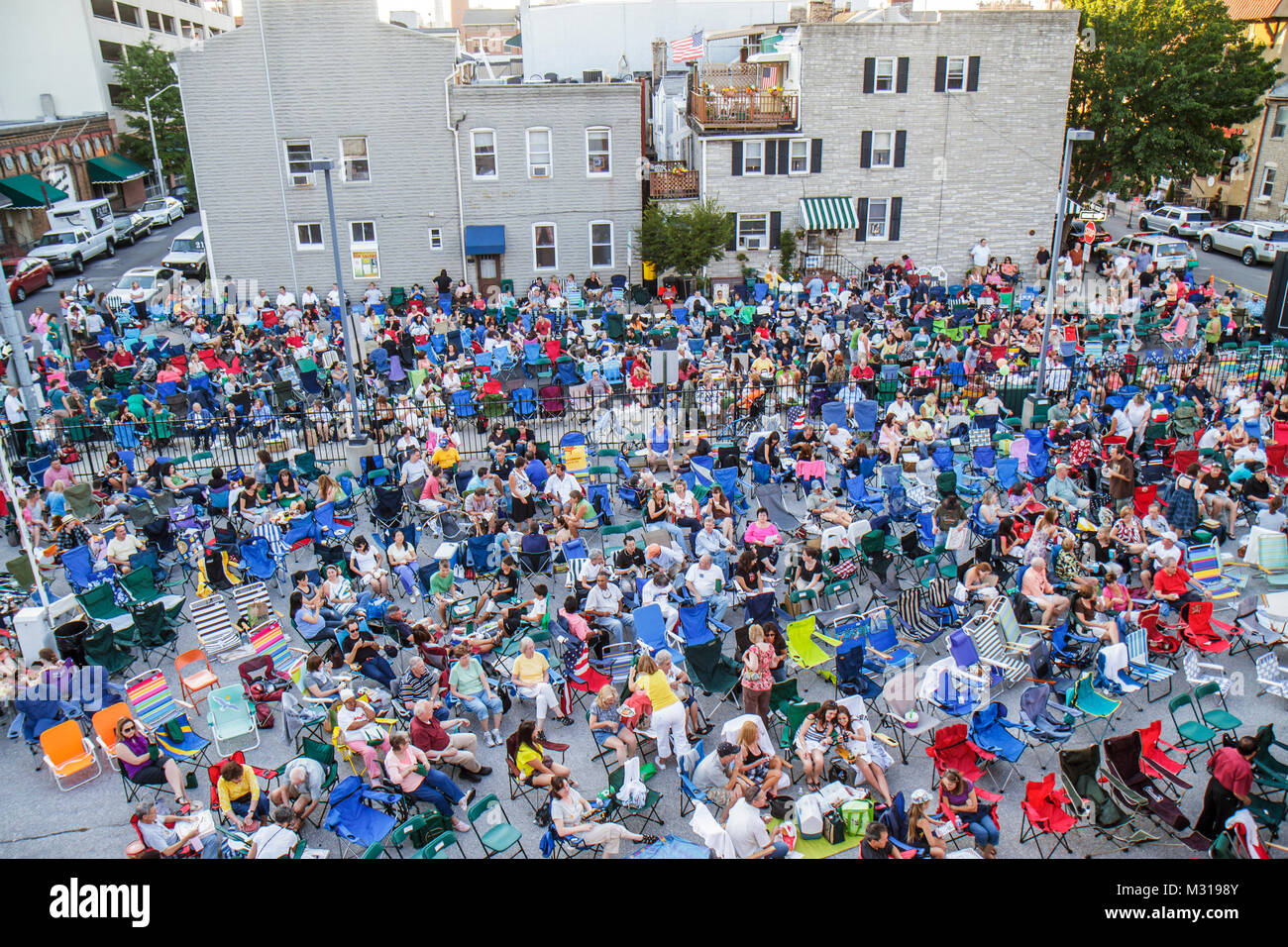 Baltimore Maryland Little Italy Ethnic Neighborhood Working Class Community  Event Crowd Free Outdoor Movie Lounge Chair