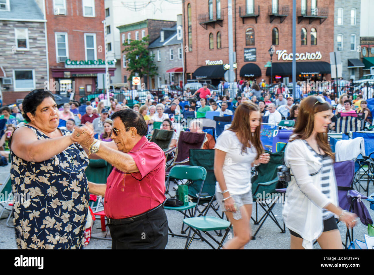 Baltimore Maryland Little Italy ethnic neighborhood working class community event crowd free outdoor movie lounge - Stock Image