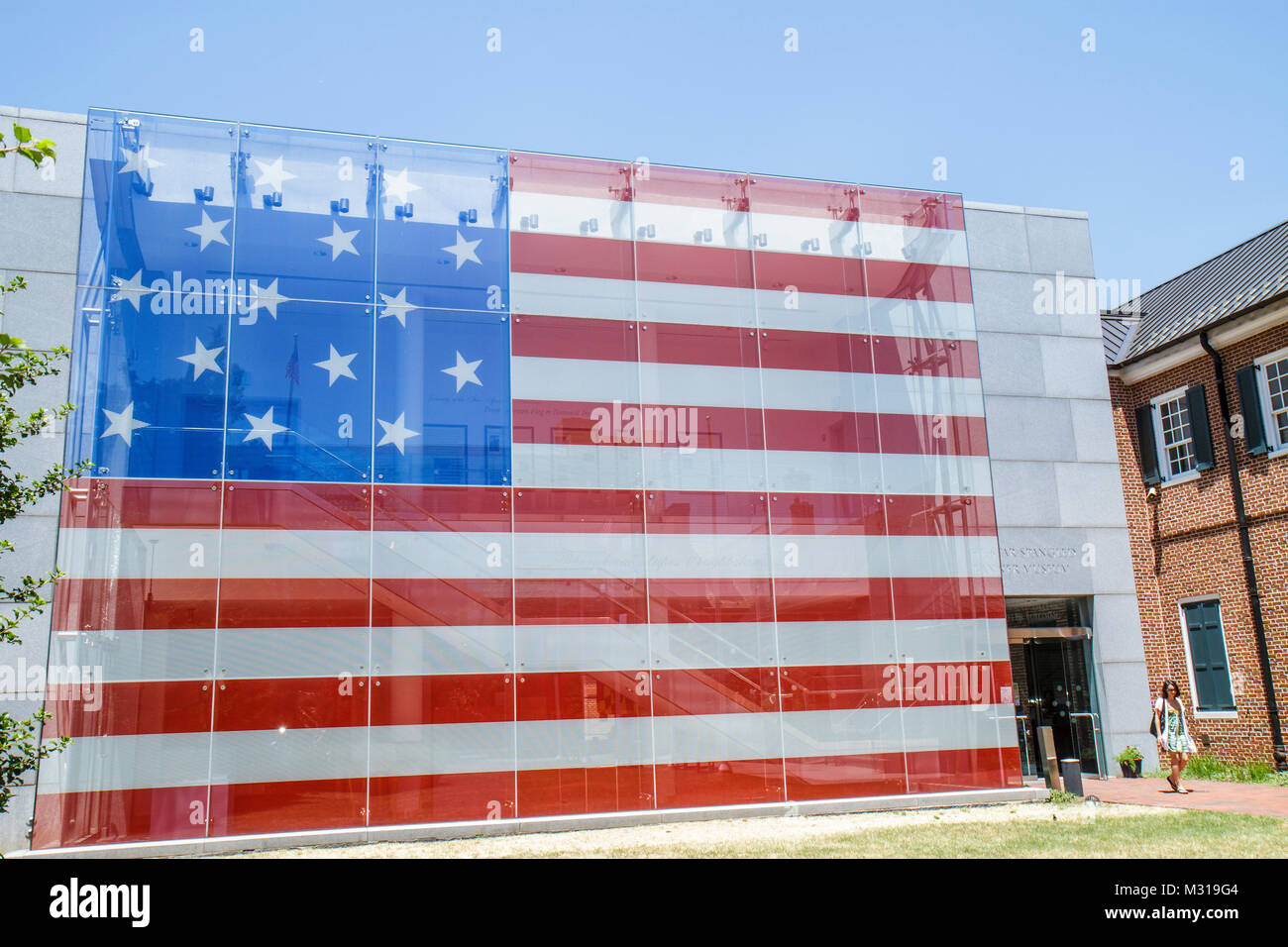 Baltimore Maryland East Pratt Street Star Spangled Banner Flag House building facade red white and blue woman walking Stock Photo