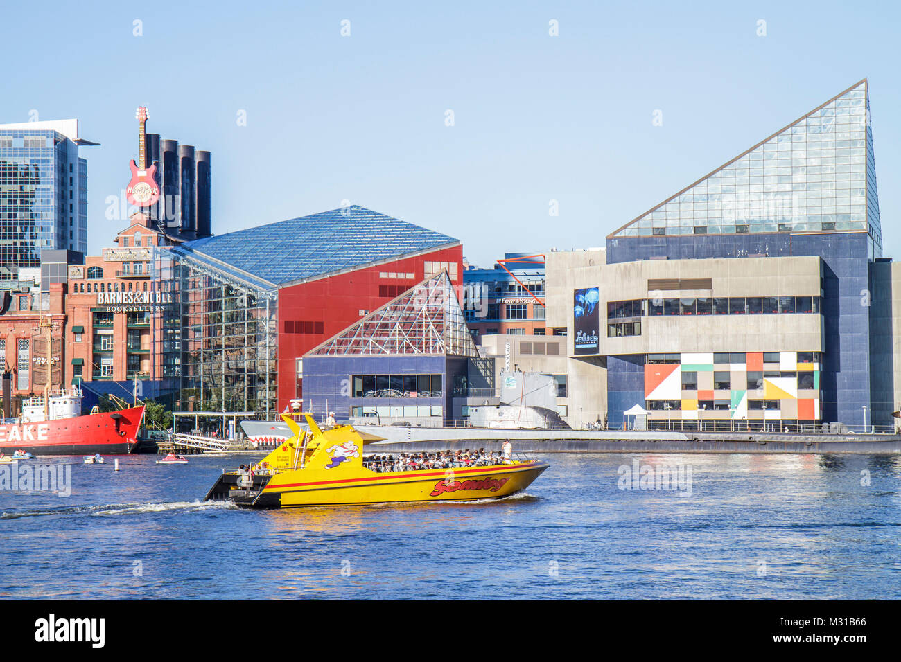 Baltimore Maryland Inner Harbor Harborplace Patapsco River waterfront National Aquarium skyline Seadog Speedboat - Stock Image