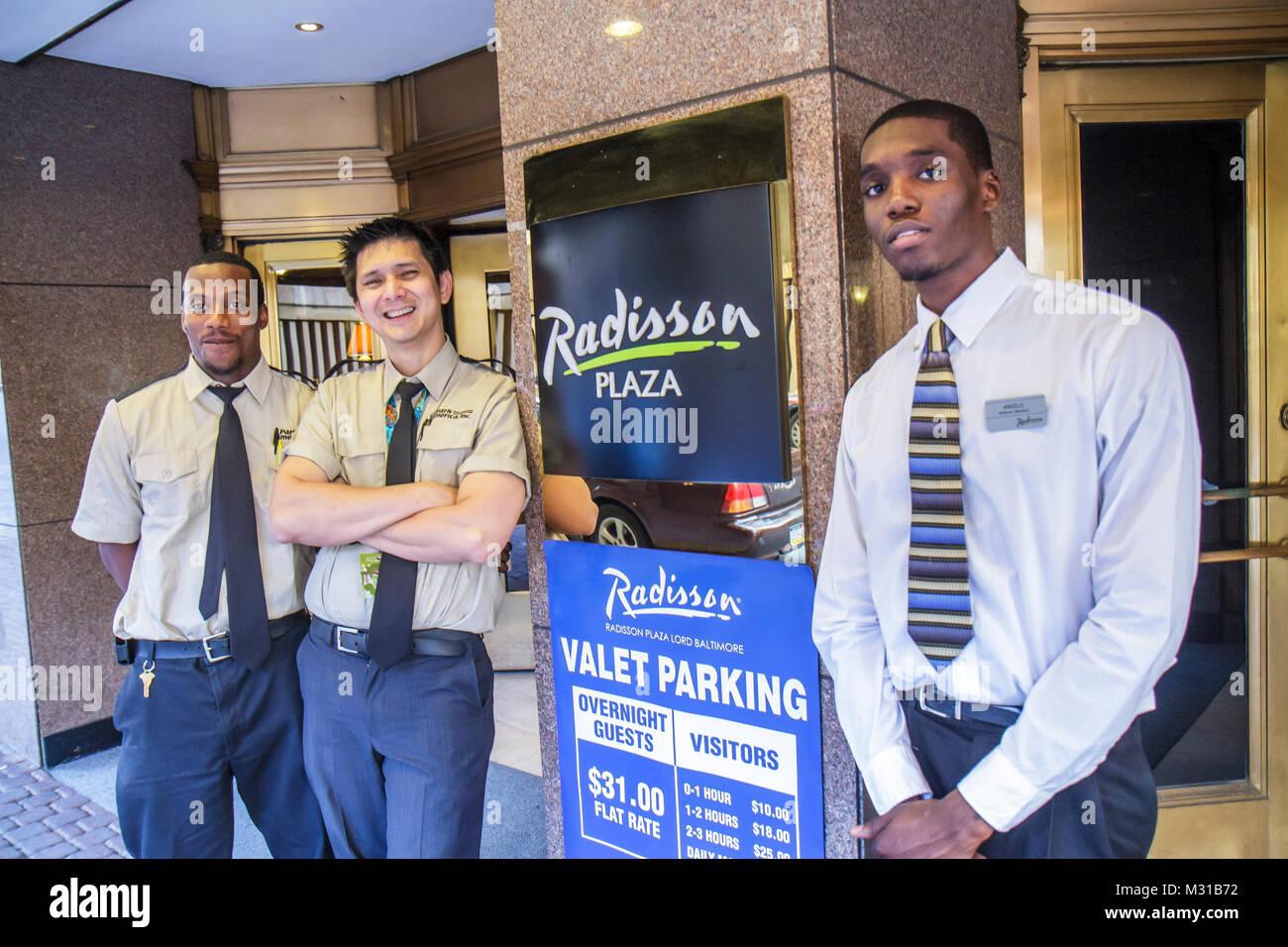 Baltimore Maryland Radisson Plaza Lord Baltimore Hotel global company business lodging Black man job employee parking - Stock Image