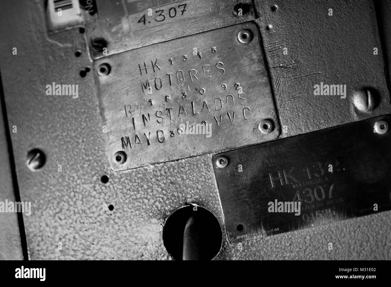 Data plates, showing the engines installation date, are seen in the cockpit of a Douglas DC-3 aircraft at the airport - Stock Image