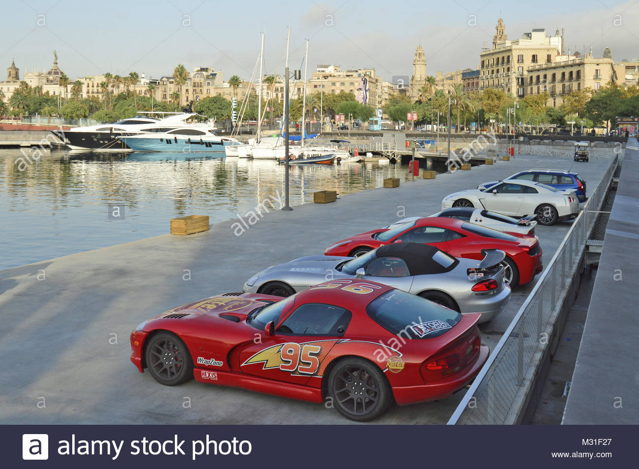 Sports cars parked in Port Vell, Ciutat Vella Barcelona Spain Europe - Stock Image